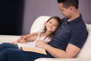 a father's example caron cline father and daughter reading Bible Burke County