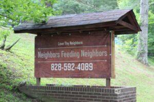neighbors feeding neighbors sign