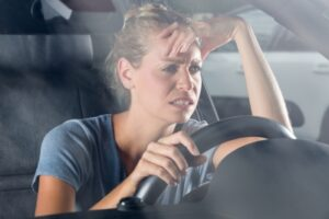 woman in car whining