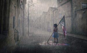 little girl fading american flag in rain God help us